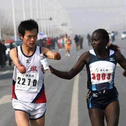 A Kenyan elite runner passes water to a dehydrated disabled Chinese runner who was suffering. This slowed her time--she came in 2nd in the race--not only costing her the win but also the $10,000 cash prize. It's not all about winning.