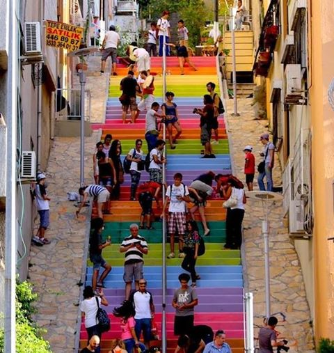 A 64 year-old man in Istanbul decided to brighten the neighborhood by painting rainbow colors on some wide, gray, crumbling stairs. When municipal officials sent workers after nightfall to hurriedly repaint the steps gray, a quiet revolution started on Twitter. Not only did volunteers come out to repaint those stairs that Huseyin Cetinel had spent hundreds of dollars on, they painted other stairs and walkways in cities around Turkey, posting photos on social media. A Pandora's Box of color had unwittingly been opened.