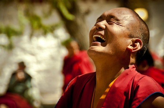 Monk laughing